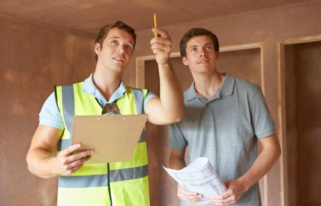 Homebuyers looking for a house with the home inspector
