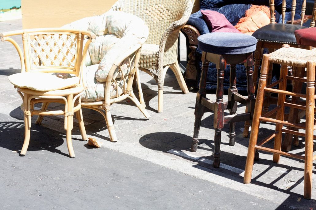 Surplus furniture displayed outside the basement