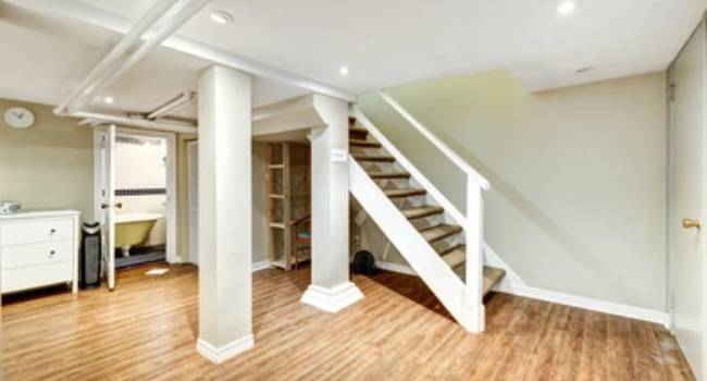 Fully Finished Basement of Newly Renovated Home With Traditional Type of Staircase.