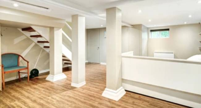 Traditional Interior of Finished Basement In A Renovated House Located At Suburbs.
