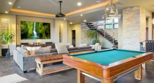 A Recreation Room Located In The Finished Basement Area of A Luxury House.